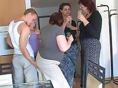 Muscular stud has group sex with mature ladies in kitchen
