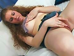 Curly gal is fingering her hairy hole before blowjob